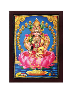 Goddess Lakshmi on lotus surrounded by kalasam