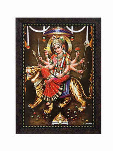 Goddess Durga on tiger in red saree in sanctum background