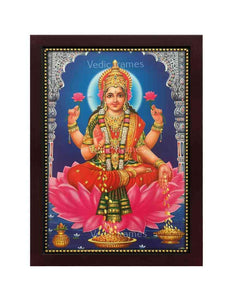 Goddess Lakshmi in a blue background with designed pillars