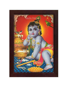 Little Krishna eating butter in orange background