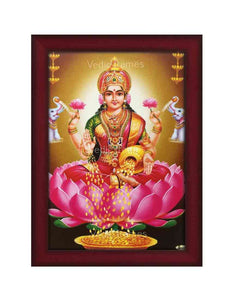 Goddess Lakshmi on pink lotus with elephants on either side in brown background