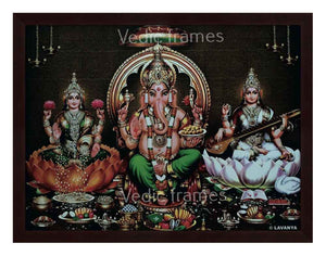 Lord Ganapathi with Lakshmi and Saraswathi on sides in sanctum background with hanging deepam