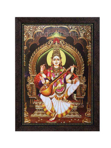 Goddess Saraswathi on golden throne in arch and pillar background