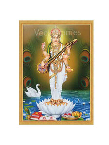Goddess Saraswathi standing on white lotus in a river with peacock feather background