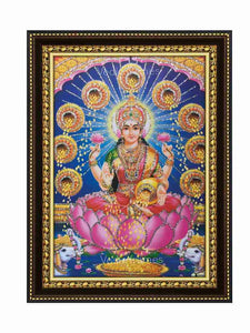 Goddess Lakshmi surrounded by showering kalasam in blue background glow sand finish