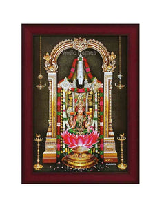 Lakshmi Venkateshwara in prabhai with hanging deepam in sanctum background