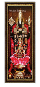 Lakshmi Venkateshwara with rose garland in sanctum Vertical