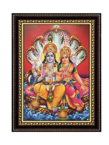 Lord Vishnu with Lakshmi seated on Adiseshan in red background