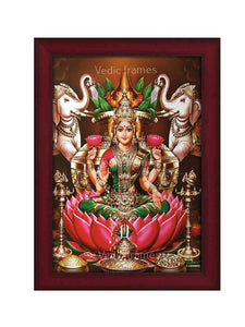 Goddess Lakshmi holding pink lotus with Kalasam, vilakku and elephants on either side