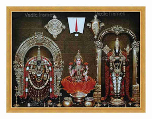 Lakshmi with Padmavathi and Lord Venkateswara in sanctum background with Sangu Chakra on top
