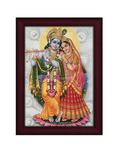 Radha Krishna on lotus in silvery background designed with peacock feathers
