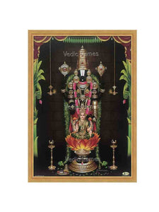Lakshmi Venkateshwara with sara vilakku in sanctum background with plantain leaves