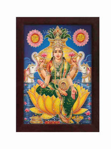 Lakshmi in green vasthram on lotus with kalasam behind glow sand finish