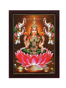 Goddess Lakshmi in a golden brown background with two elephants on either side