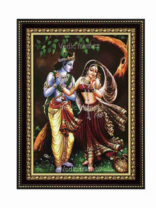 Lord Krishna holding Radha's hand under a tree