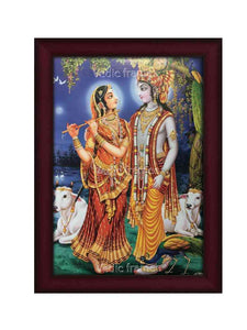 Lord Krishna and Radha facing each other in moonlight background