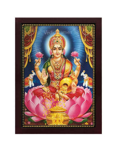 Goddess Lakshmi with halo in dark blue background