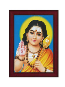 Sakthi Vadivelan with golden halo in blue background