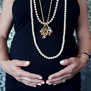 Pregnant woman wearing necklaces