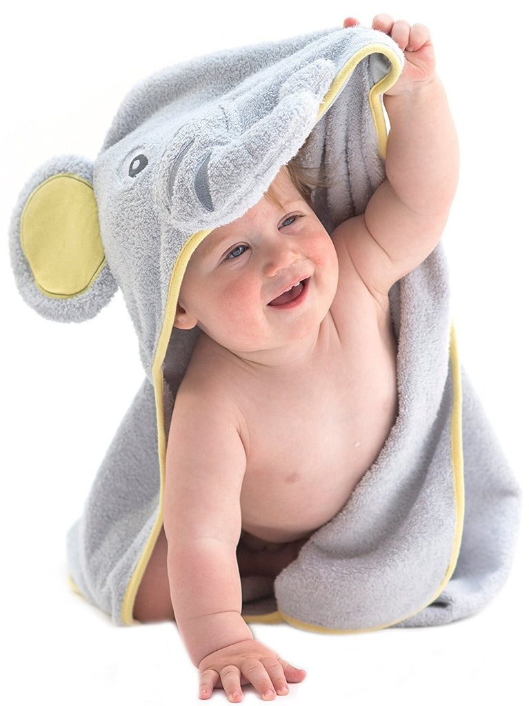 Alt = Baby facing forward wearing hooded towel with elephant hood
