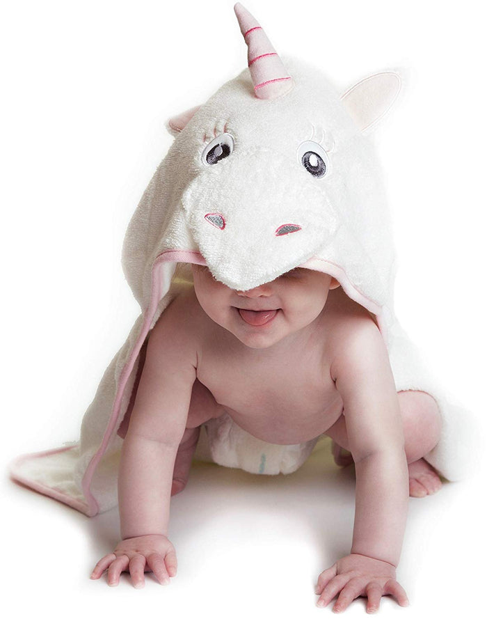 Alt = Baby leaning forward wearing Pink Unicorn hooded towel