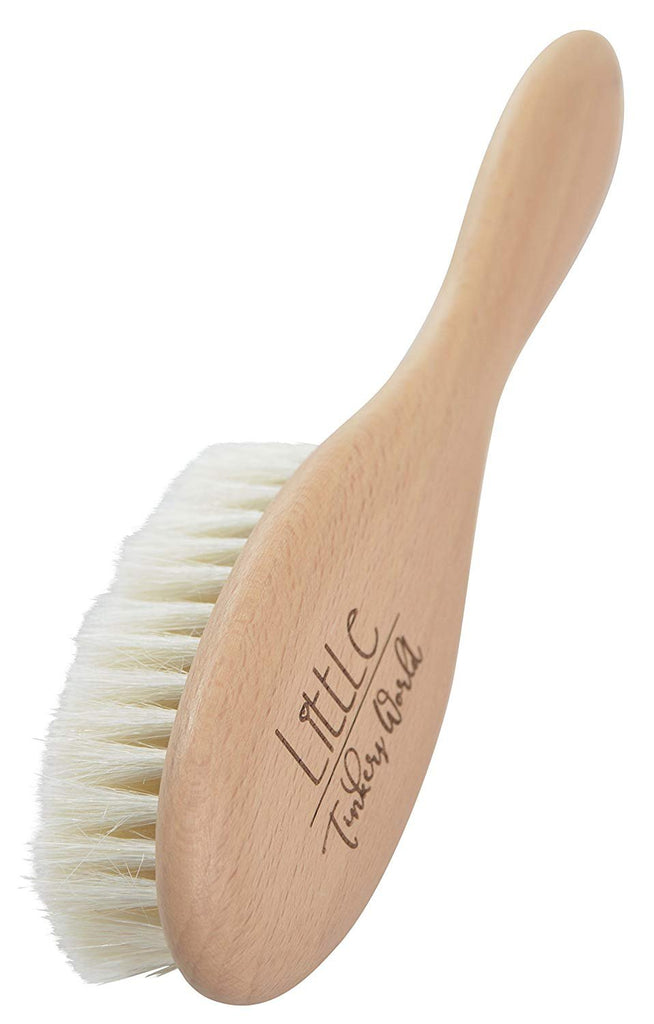 ALT = Close up of Single wooden brush