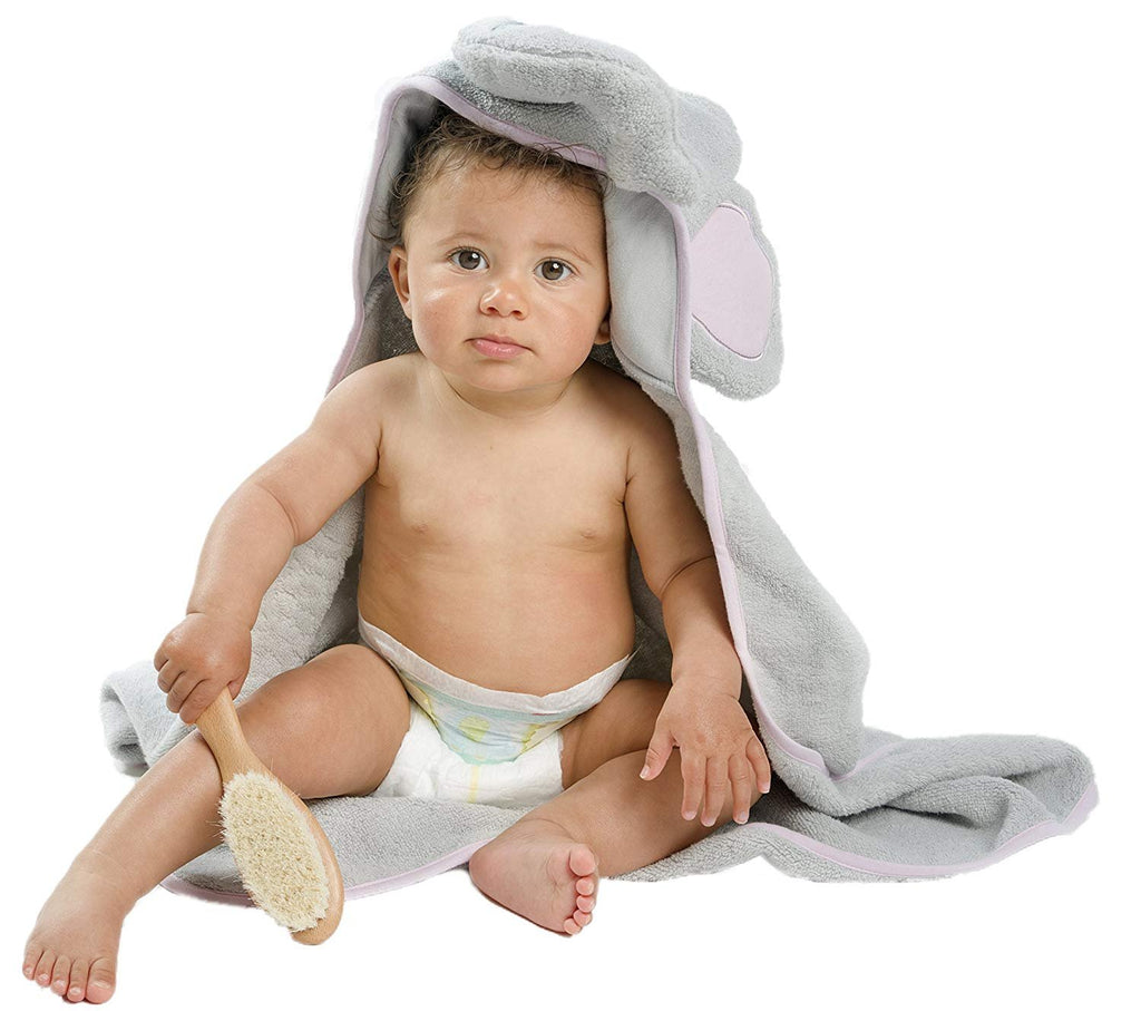 ALT = Baby facing forward with grey elephant hooded towel holding brush with right hand