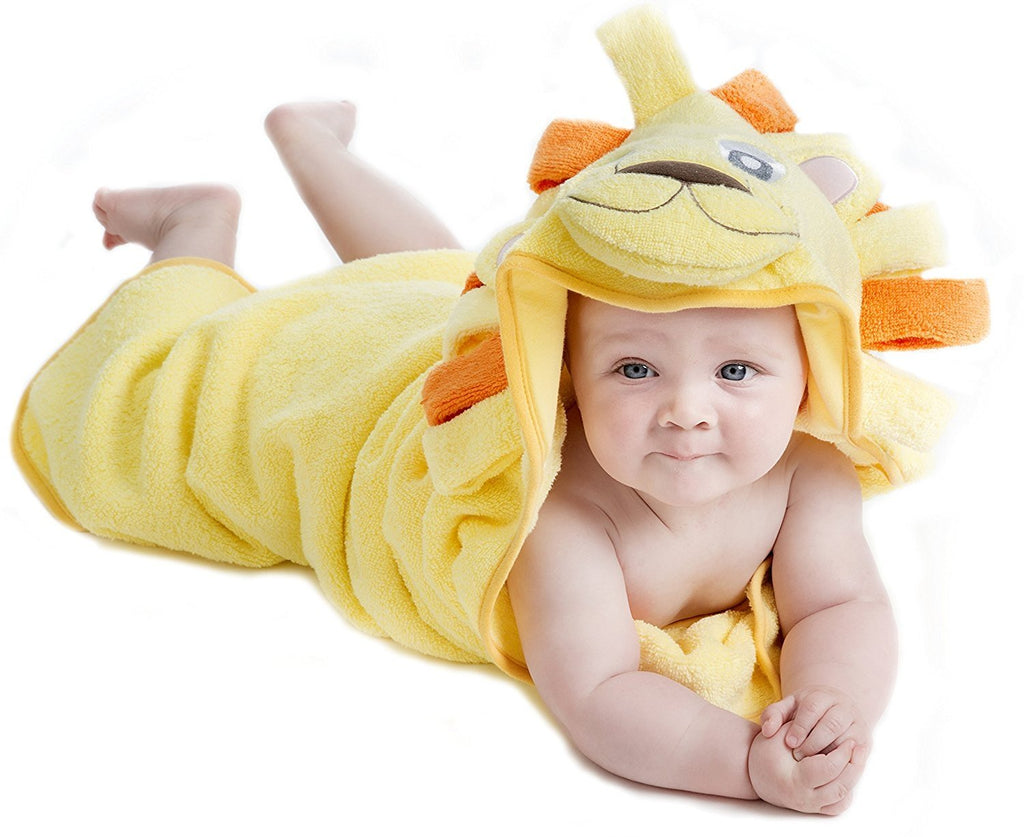 Alt = Baby lying on tummy wrapped in Lion hooded towel
