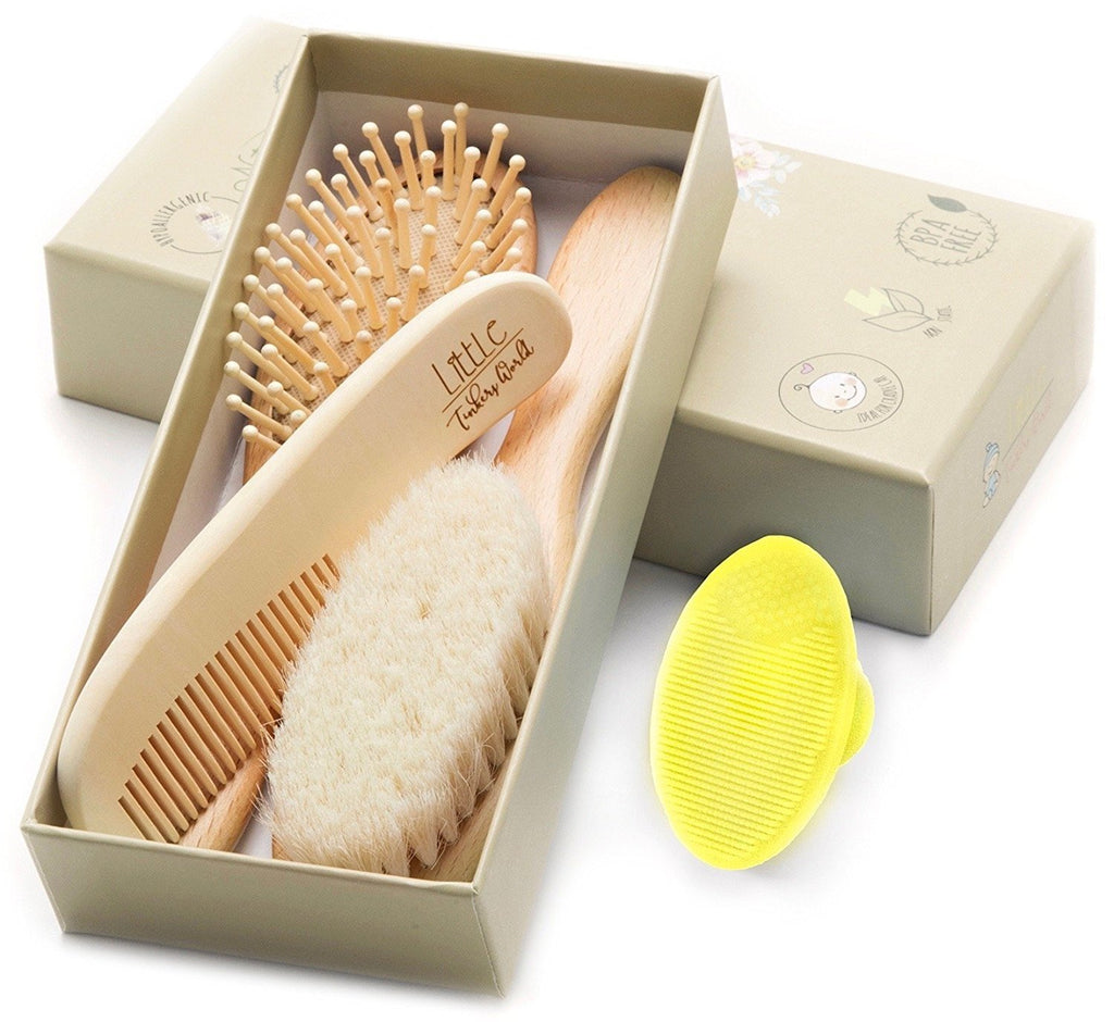 Alt = Wooden baby brush set 4 Pieces shown inside the brown box  packaging tilted up