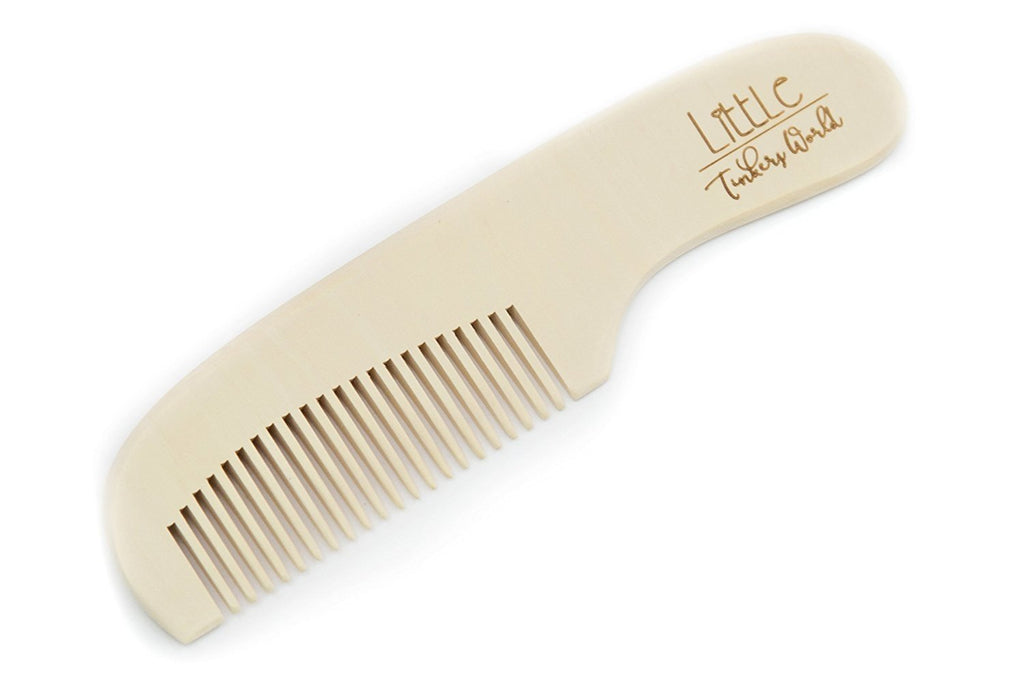 Alt= Close up of the wooden baby comb