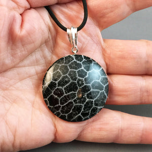 Black fossil coral and sterling silver pendant