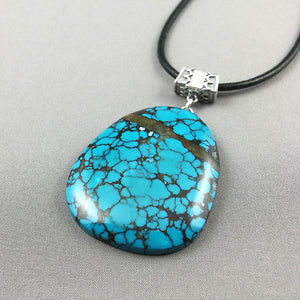 Natural turquoise and sterling silver pendant