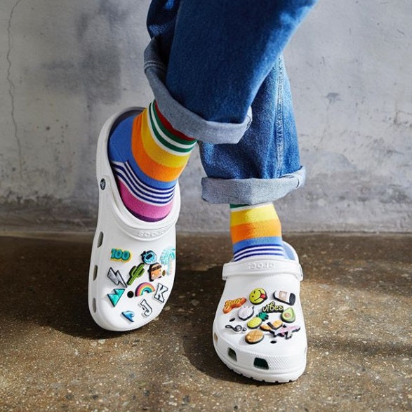 Crocs Jibbitz with multicolored socks.