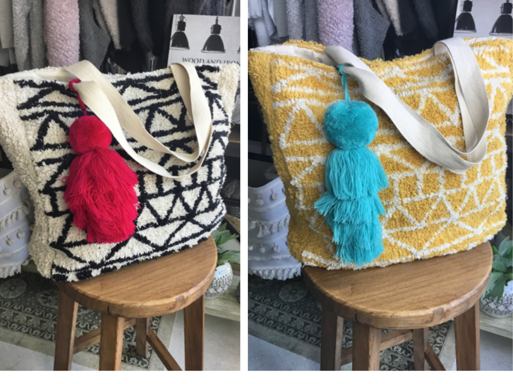 "Shaggy Carpet tote is cotton lined with an inner zip pocket and snap enclosure. Tote is 18""x18"" at $89. Turquoise Pom Pom tassel is $24."