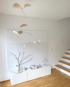 Handmade in Denmark, this mobile is Kathy's favorite.  Lightweight wooden clouds drift and move with just a slight motion of air as you dream of peaceful moments. Easy to install....easy to enjoy.