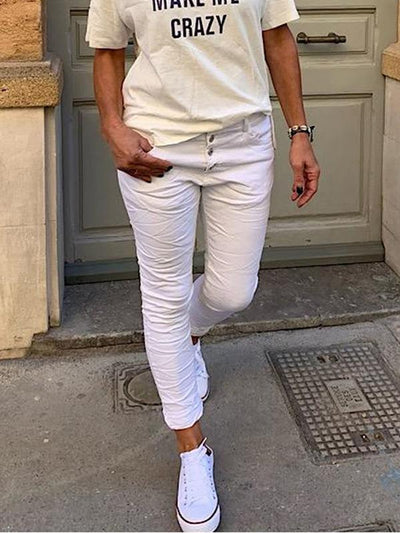 Solid color trousers with pockets