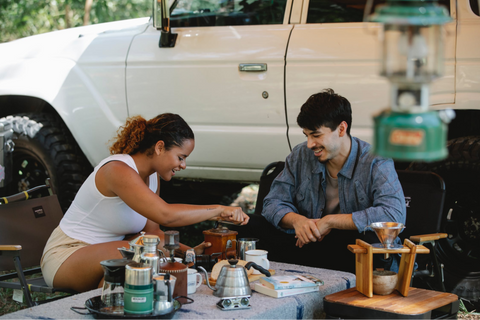 Couple making coffee while camping