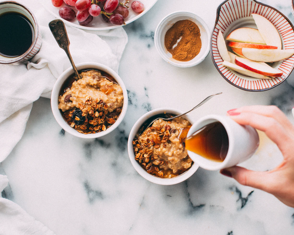 Hot cereal bowls with cinnamon, fruit and syrup