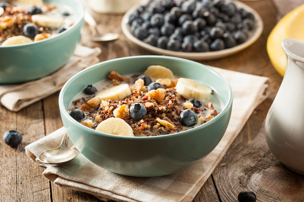 Bowl of Hot cereal with bananas, blueberries, and walnuts
