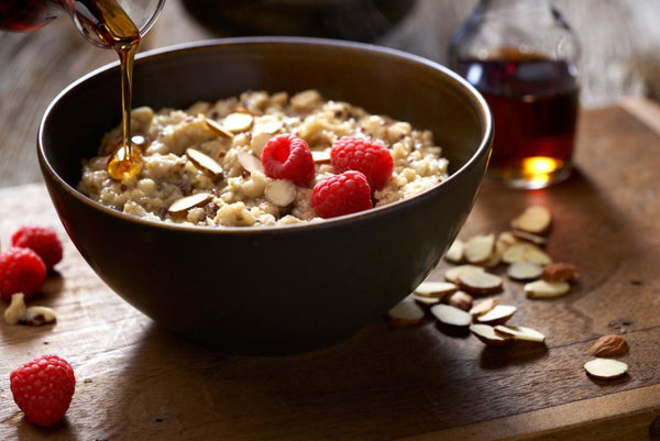 Instant pot oatmeal with almonds, berries and syrup