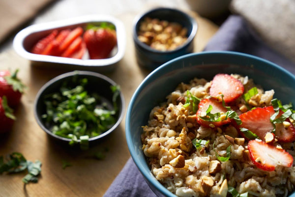 Low-fat breakfast of oatmeal with nuts and berry toppings