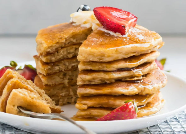 Gluten free Oatmeal pancakes with better syrup and strawberries