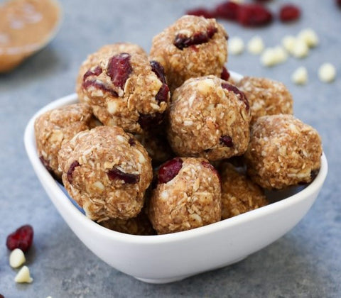 A bowl of White Chocolate cranberry oatmeal energy balls