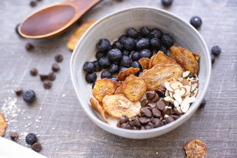 Bowl of oatmeal with fruit and chocolate chips