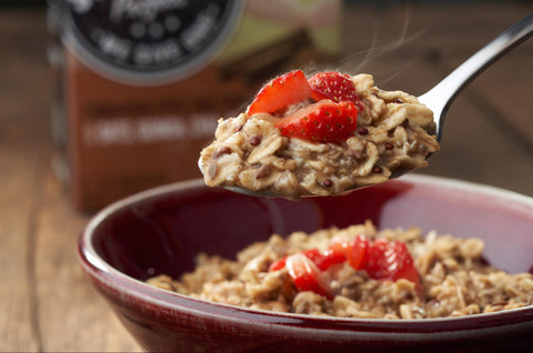 Spoonful of oatmeal with fruit