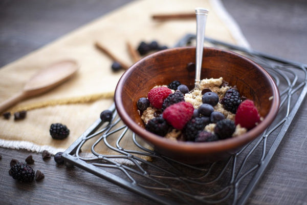 office breakfast idea of bowl of oatmeal with fruit toppings
