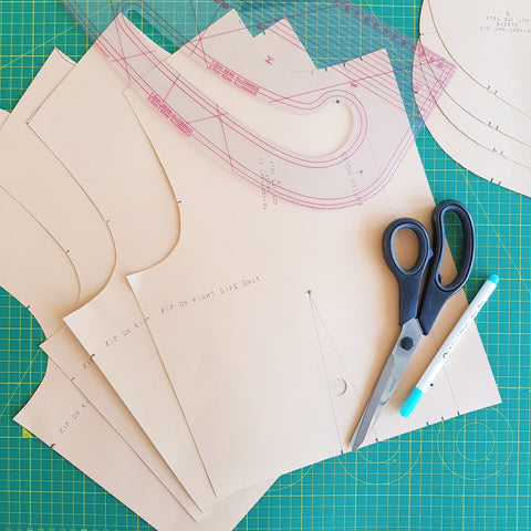 How our garments are made. The dress pattern graded into different sizes.