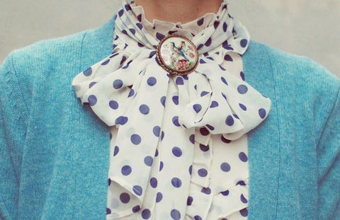 vintage brooch and pussy bow polka dot blouse