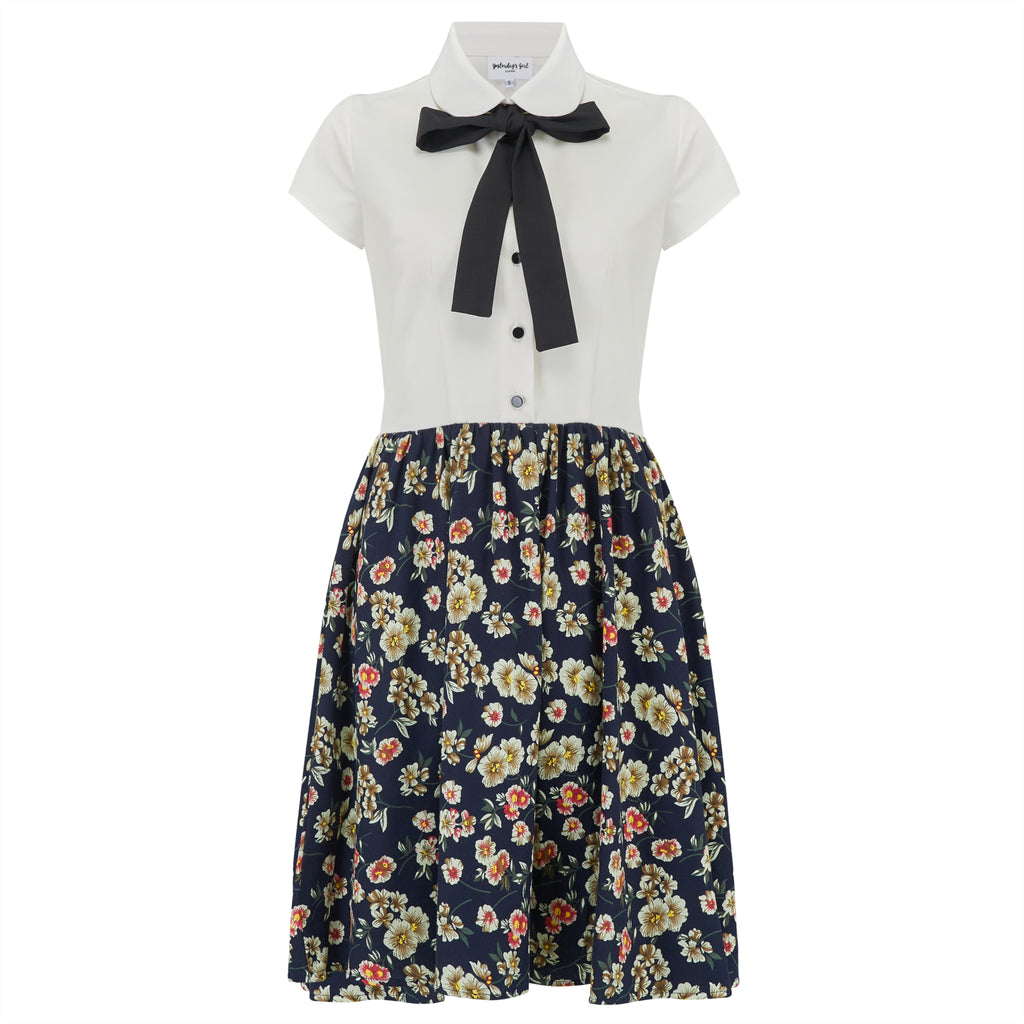 vintage inspired retro shirt dress with button down blouse front and gathered floral skirt collar and bow neck tie