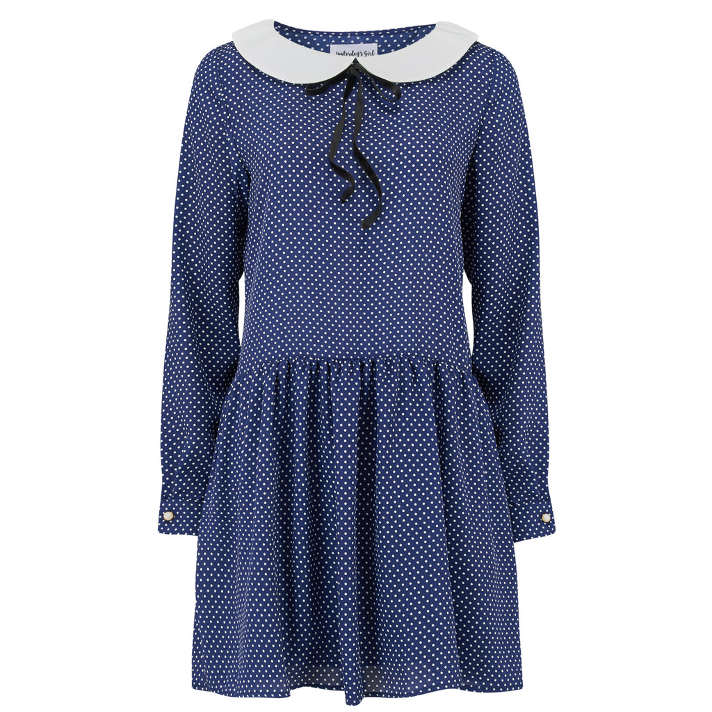 Navy polka dot drop waist swivel dress with peter pan collar and black bow necktie.